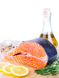 Fresh salmon steak on wooden cooking desk Royalty Free Stock Photography