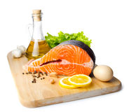 Fresh salmon steak on wooden cooking desk Stock Photos