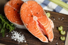 Fresh salmon steaks, close up. Fresh salmon steaks on a wooden cutting board, close up Stock Image