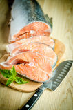 Fresh salmon steaks. On the cutting board Royalty Free Stock Image