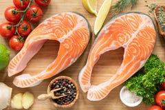 Fresh salmon steaks on cutting board stock photos