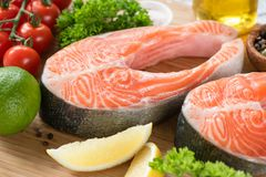 Fresh salmon steaks and ingredients for cooking stock photos