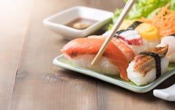 Fresh Salmon sushi on chopstick, Japaness food Stock Photo