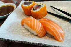 Fresh Salmon sushi and tuna maki rolls Royalty Free Stock Photo