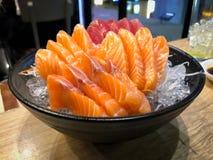 Fresh Salmon and tuna fish slide. Japanese food, Fresh Salmon and tuna fish slide on ice stock photography