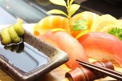 Fresh salmon tuna sushi set with chopsticks wasabi Royalty Free Stock Images