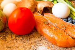 Fresh salmon with vegetable. Fresh salmon and vegetabel on a counter Stock Photography