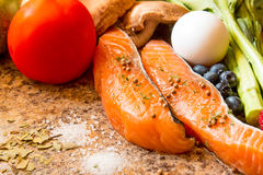 Fresh salmon with vegetable. Fresh salmon and vegetabel on a counter Stock Photos