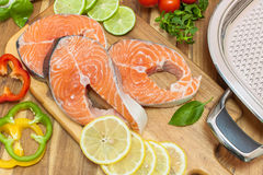 Fresh salmon, vegetables and herbs Stock Image