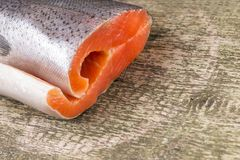 Fresh Salmon on weathered wooden board Stock Image