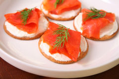 Fresh salmon on whole wheat crackers Stock Photos