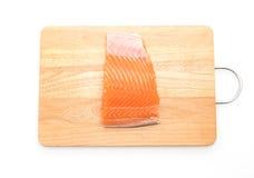Fresh salmon on wood board Stock Photography