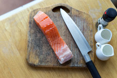 Fresh salmon on a wooden cutting board,. Cut preparation Royalty Free Stock Photography