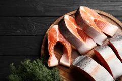 Fresh salmon on a wooden table royalty free stock photography
