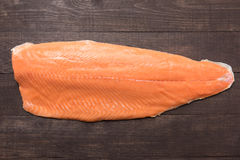 Fresh salmon on the wooden table. Top view Royalty Free Stock Photography
