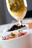 Fresh Salsa and Beer. Fresh homemade salsa with tomatoes, red onions and cilantro, with a bowl of black beans and a beer in the background royalty free stock photo