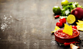 Fresh salsa dips with nachos chips on old background Royalty Free Stock Images