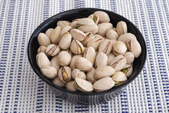 Fresh salted pistachios Stock Photography