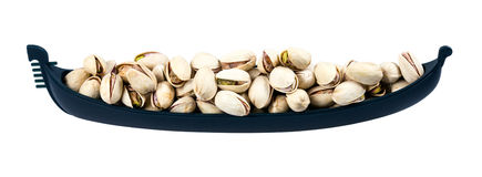 Fresh Salted Pistachios in boat.  Stock Photo