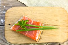 Fresh salted salmon fillet with parsley and onion on a wooden bo. NFresh salted salmon fillet with parsley and onion on a wooden board. Concept of healthy food Royalty Free Stock Photo