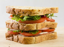 Fresh sandwich bread tomatoes lettuce and ham. Close up Stock Image