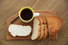 Fresh sandwich with cheese on a wooden board with coffee for breakfast Stock Photo