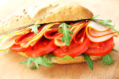 Fresh sandwich with chorizo and tomatoes Royalty Free Stock Photo