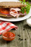 Fresh sandwich with ham and ketchup Stock Images