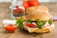 Fresh sandwich with ham and tomato Royalty Free Stock Image