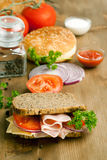 Fresh sandwich with ham and tomato Stock Images