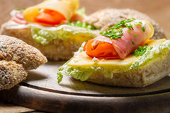 Fresh sandwich made of chive, ham lettuce and cheese Royalty Free Stock Photos