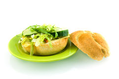 Fresh sandwich stuffed with lettuce. Isolated on white background royalty free stock photos