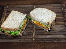 Fresh sandwich on the wooden table , Delicious breakfast. royalty free stock photo
