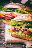Fresh sandwiches on cutting board. Freshly made sandwiches on cutting board Stock Images
