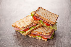 Fresh sandwiches meal on wooden background Stock Photography