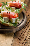 Fresh sandwiches on a old wooden cutting board Royalty Free Stock Photos