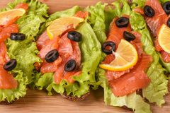 Fresh sandwiches with red fish and lemon. Close up Royalty Free Stock Photos