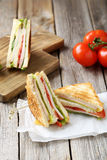 Fresh sandwiches. Tasty and fresh sandwiches on a grey wooden table Royalty Free Stock Images