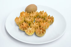 Fresh Sapodilla fruit carving on the plate.  Royalty Free Stock Photo