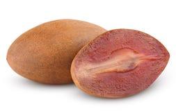 Fresh sapodilla plum with cut on white Stock Images