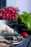 Fresh sardines. Fish with vegetables. Stock Photos