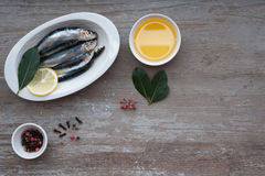 Fresh sardines. Omega 3. Fish with herbs. Mediterranean fish on plate Stock Photo