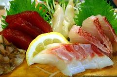 Fresh Sashimi. With a lemon royalty free stock photo