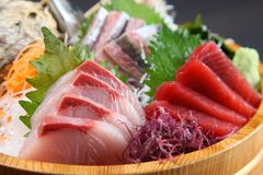 Fresh sashimi combo in a tub. Close up studio shot of fresh sashimi combo in a tub royalty free stock images