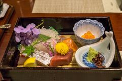 Fresh sashimi plate. Served on top of bamboo plates. Served in a ryokan located in Yufuin, Japan royalty free stock photo