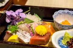 Fresh sashimi plate. Served on top of bamboo plates. Served in a ryokan located in Yufuin, Japan stock photo