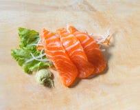 Fresh sashimi saimon on wood background Royalty Free Stock Photo