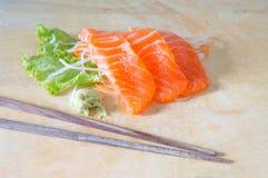 Fresh sashimi saimon on wood background Stock Images