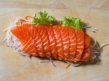 Fresh sashimi saimon on wood background Stock Photos