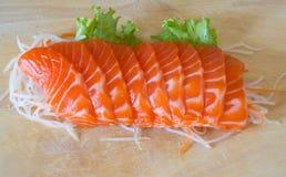 Fresh sashimi saimon on wood background Royalty Free Stock Photos